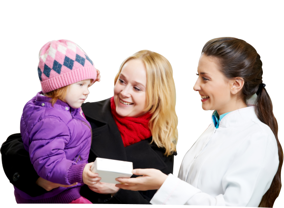 A medical professional giving a box of medicine to the child